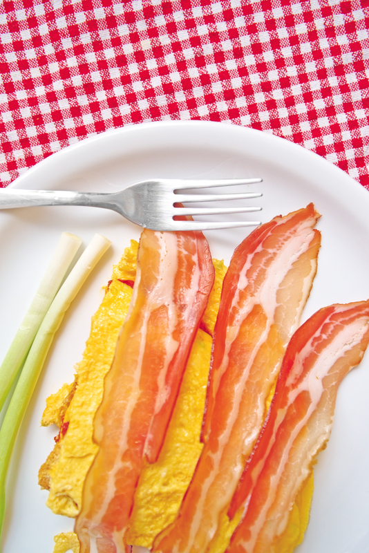 http://www.dreamstime.com/stock-photos-bacon-eggs-scrambled-green-leek-white-plate-served-as-breakfast-traditional-breakfast-lots-calories-image31312593