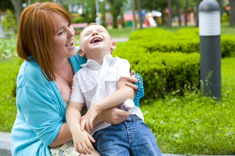 http://www.dreamstime.com/royalty-free-stock-photos-laughing-mother-her-four-year-old-son-portrait-happy-child-outdoors-image34811998