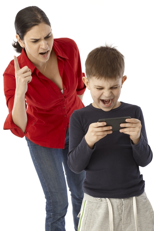 http://www.dreamstime.com/royalty-free-stock-photo-little-boy-playing-mother-s-pda-mobilephone-angry-warning-finger-image34135105