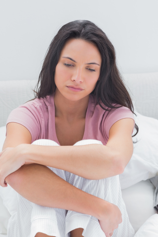 http://www.dreamstime.com/royalty-free-stock-images-anxious-woman-sat-her-bed-bedroom-image31669719