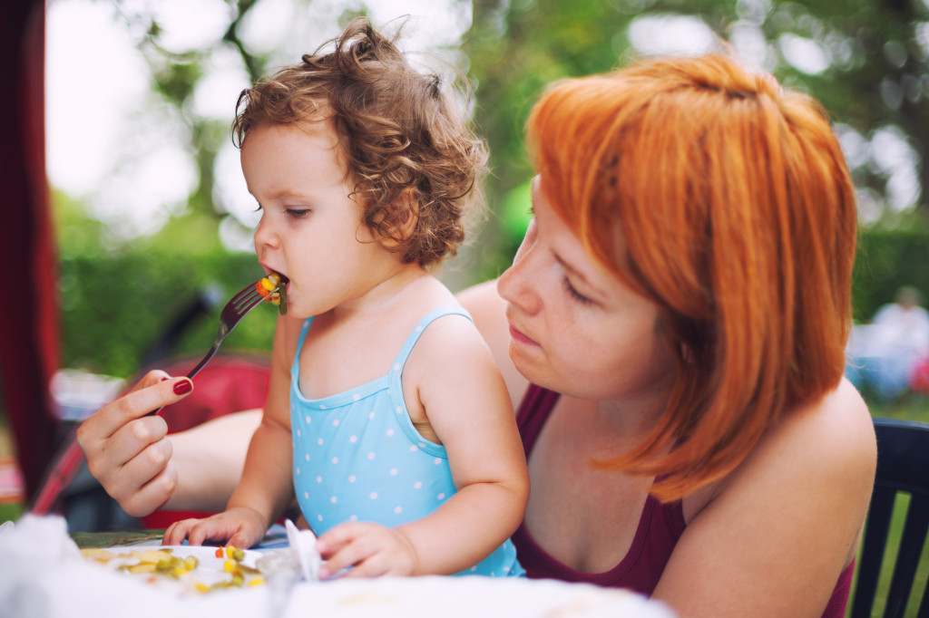 http://www.dreamstime.com/royalty-free-stock-images-feeding-baby-mother-daughter-solid-food-grilled-vegetables-image36918509