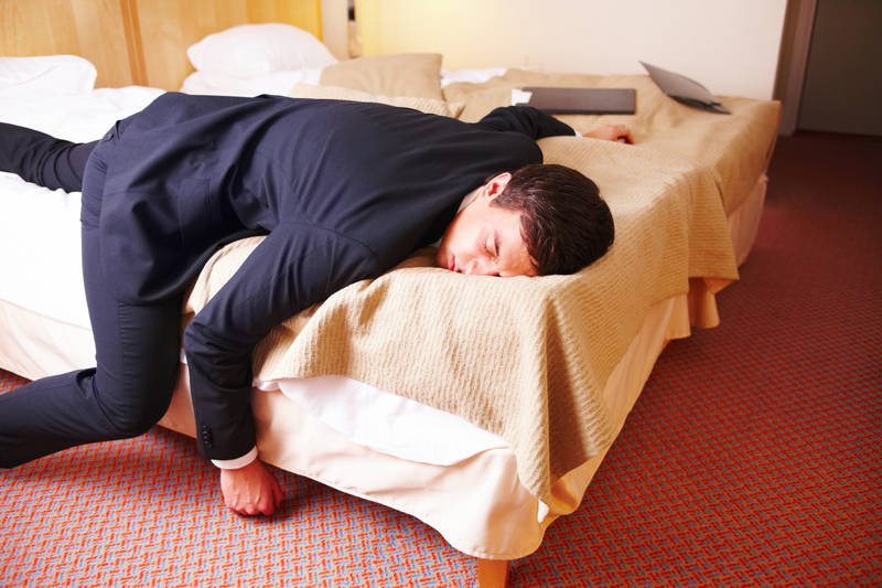 http://www.dreamstime.com/stock-photos-overworked-tired-businessman-lying-bed-image7386563