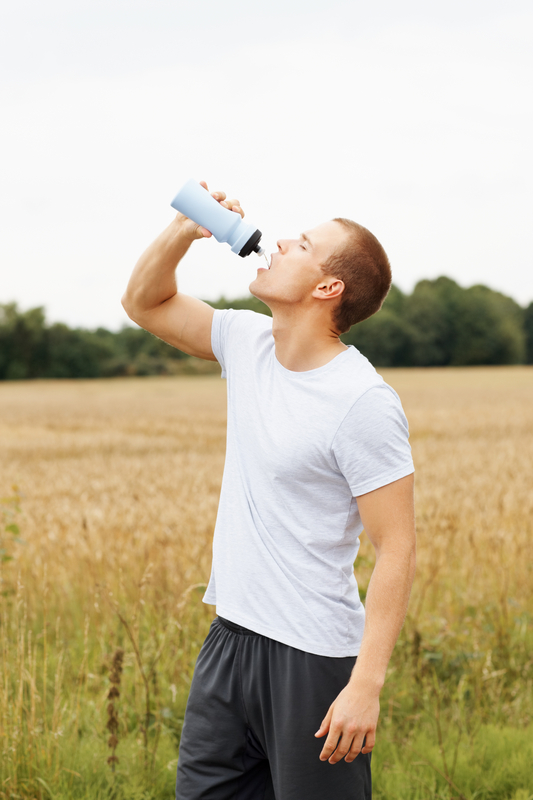 http://www.dreamstime.com/stock-photography-young-athlete-drinking-water-drink-bottle-image10535702
