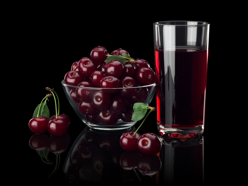 http://www.dreamstime.com/stock-photos-berries-cherry-juice-black-background-glass-vase-glass-isolated-image33648893