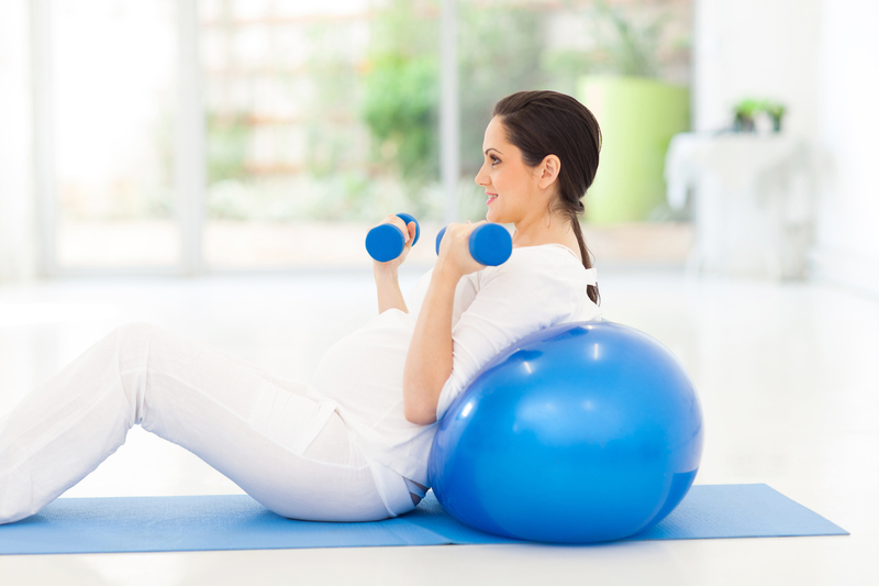 http://www.dreamstime.com/stock-photography-pregnant-woman-exercising-pretty-dumbbells-home-image33678902