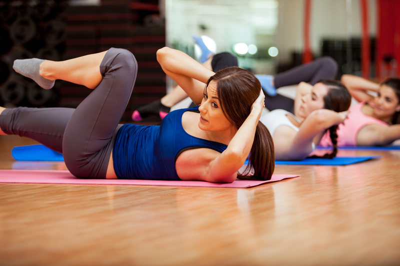 http://www.dreamstime.com/stock-image-doing-crunches-gym-class-beautiful-young-women-image35912141