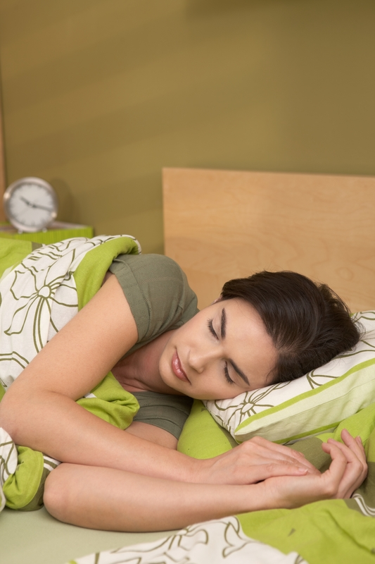 http://www.dreamstime.com/stock-photography-woman-sleeping-b-edroom-image21446402