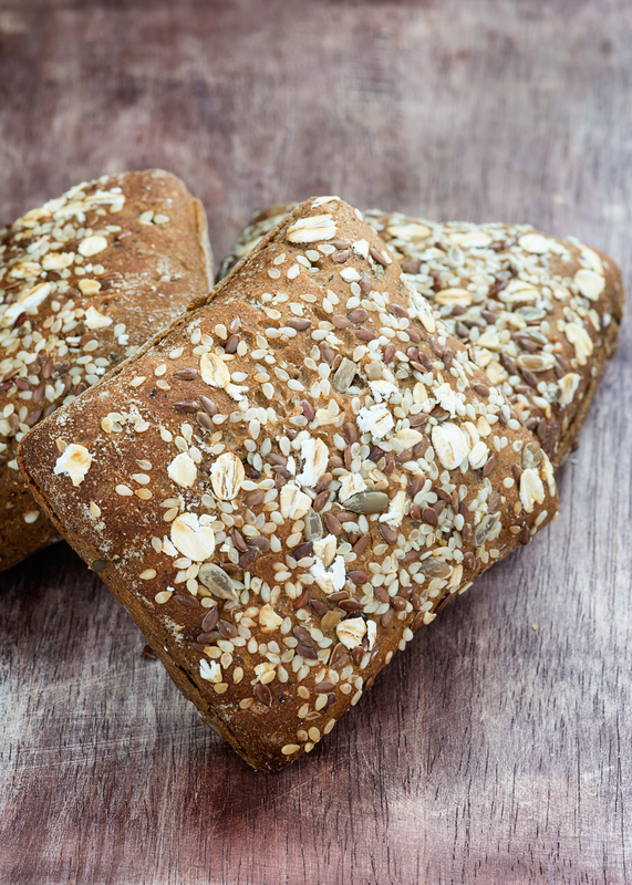 http://www.dreamstime.com/stock-image-homemade-whole-grain-bread-over-wooden-background-selective-focus-closeup-image33367501