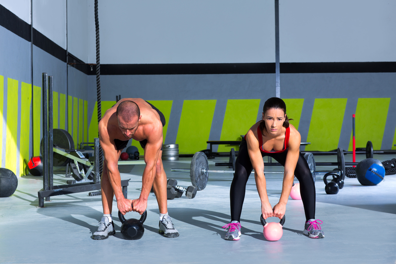 http://www.dreamstime.com/stock-photos-kettlebells-swing-crossfit-exercise-man-woman-image28359093