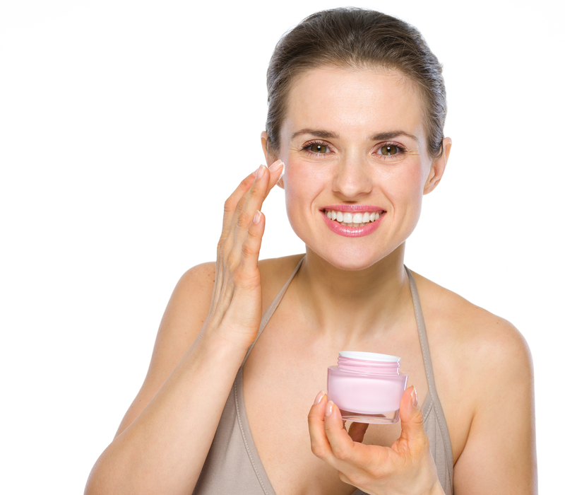 http://www.dreamstime.com/stock-image-beauty-portrait-young-woman-applying-creme-isolated-white-image31243141