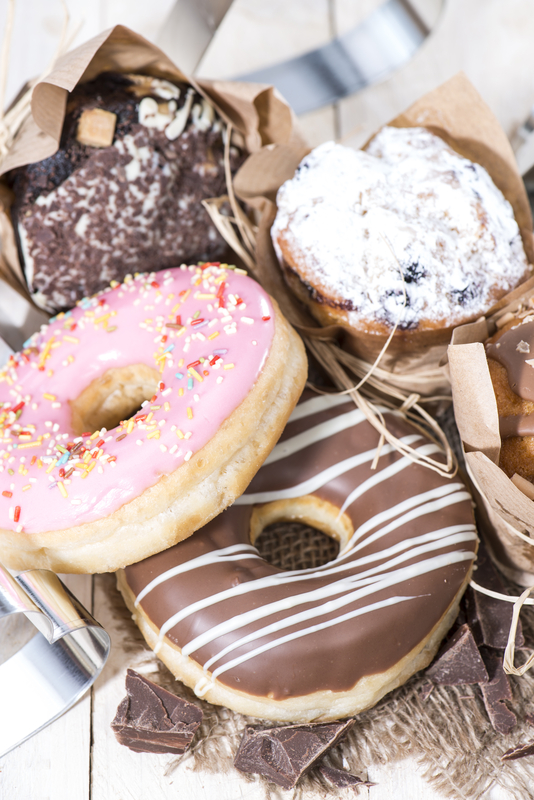 http://www.dreamstime.com/stock-image-heap-muffins-donuts-fresh-made-image35446251