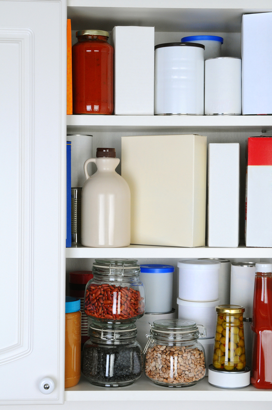 http://www.dreamstime.com/stock-photos-closeup-well-stocked-pantry-one-door-cabinet-open-revealing-canned-goods-condiments-package-foodstuffs-storage-image31546983