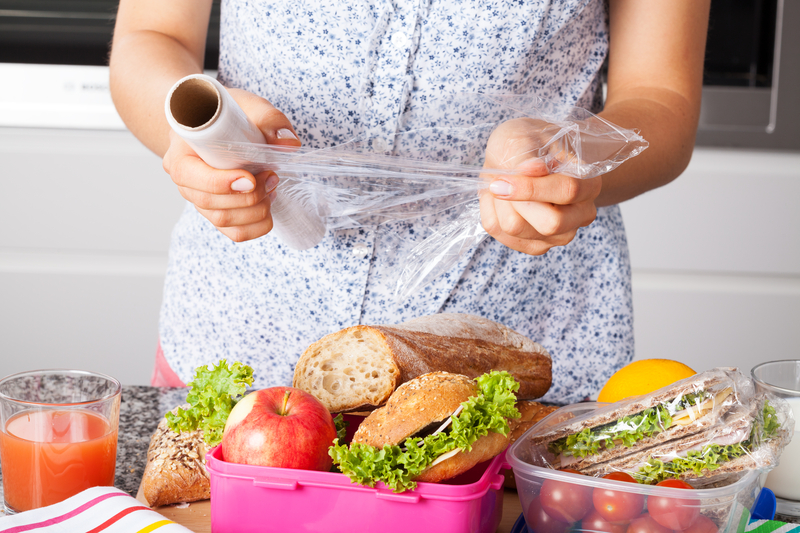 http://www.dreamstime.com/royalty-free-stock-photos-packing-food-lunch-woman-plastic-boxes-image36321158