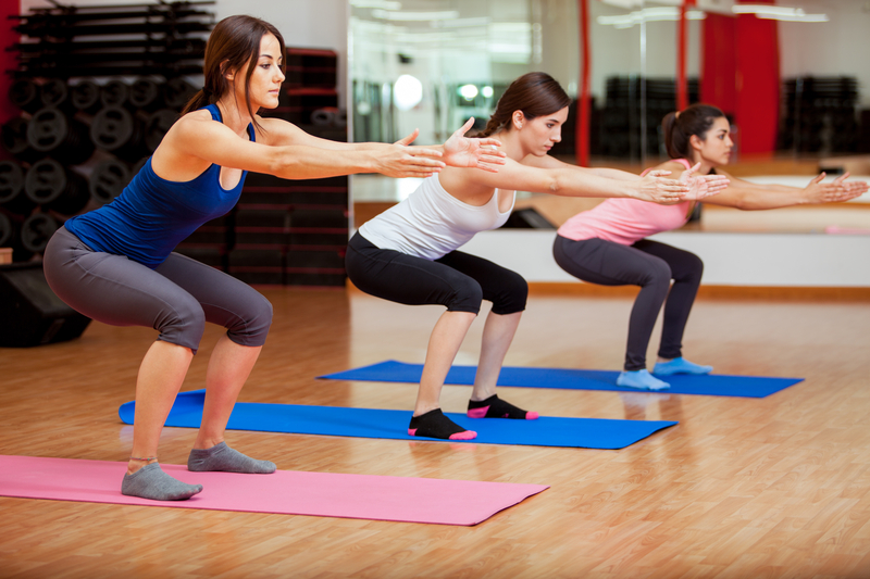 http://www.dreamstime.com/royalty-free-stock-image-cute-women-doing-some-squats-three-beautiful-young-exercising-gym-image35912216