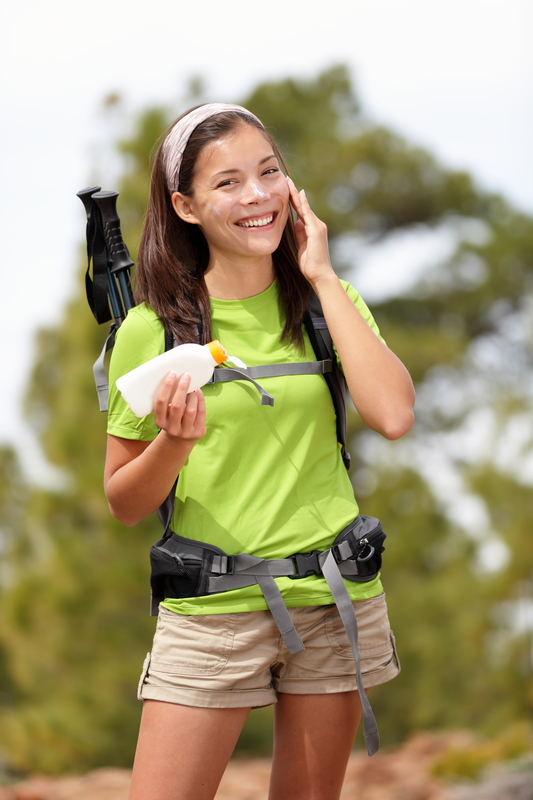 http://www.dreamstime.com/stock-photos-sunscreen-woman-hiking-applying-sun-lotion-image19422613