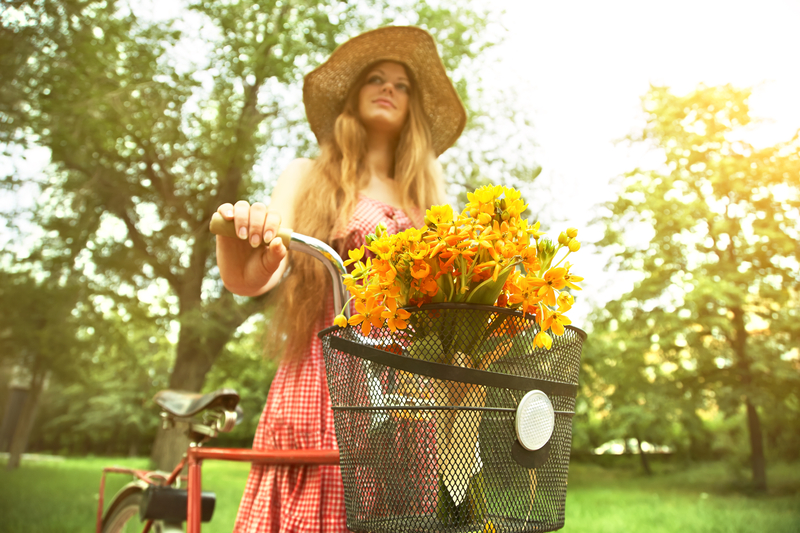 http://www.dreamstime.com/royalty-free-stock-image-woman-bike-young-park-flowers-basket-outdoors-image38340896