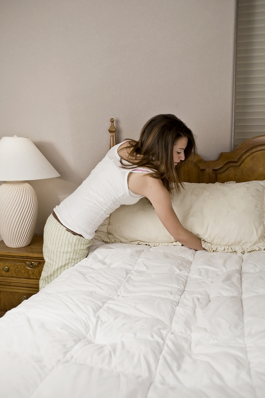 http://www.dreamstime.com/stock-photography-woman-making-bed-image7637532