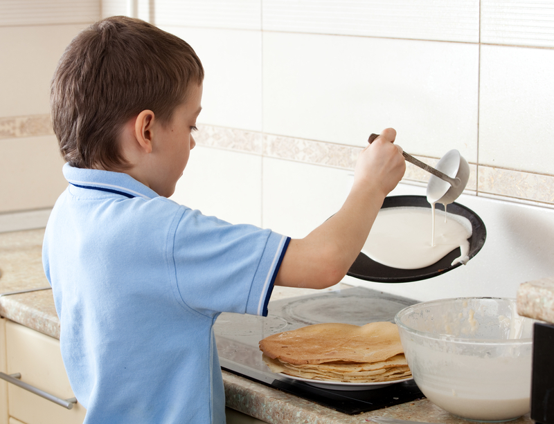 http://www.dreamstime.com/stock-images-boy-cooking-pancakes-image28712474