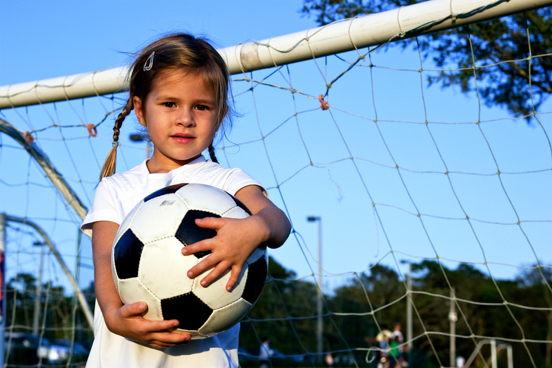 http://www.dreamstime.com/royalty-free-stock-photos-girl-playing-soccer-image27596368