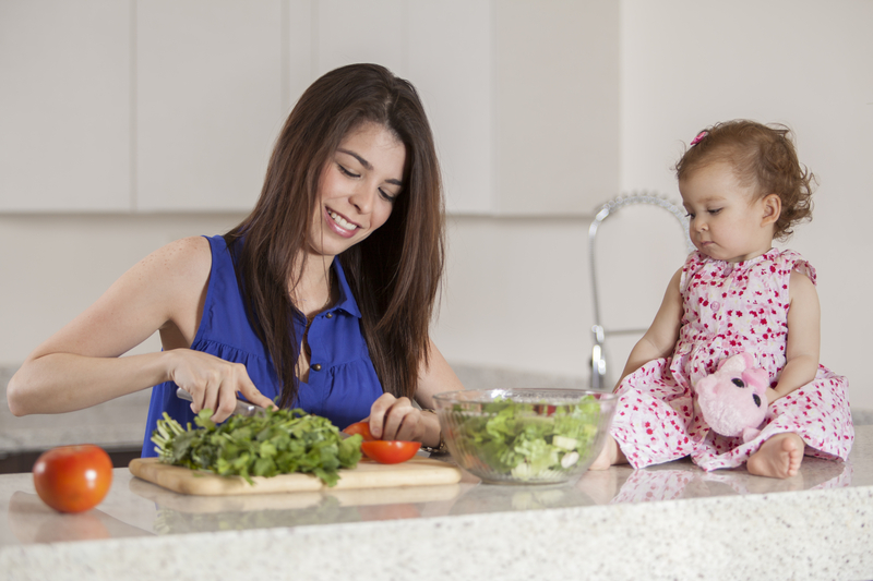 http://www.dreamstime.com/royalty-free-stock-image-mom-daughter-making-dinner-young-mother-her-baby-girl-salad-kitchen-image33828206