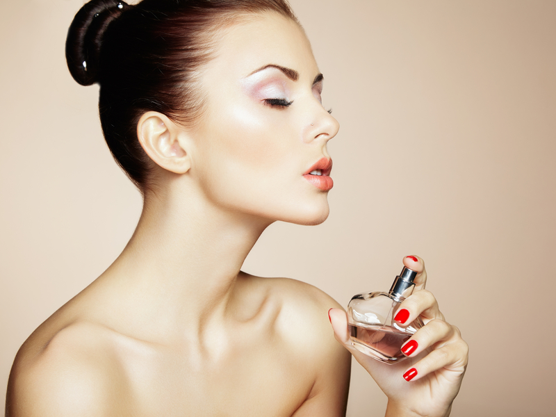 http://www.dreamstime.com/stock-images-young-beautiful-woman-bottle-perfume-perfect-makeup-fashion-photo-image33524464