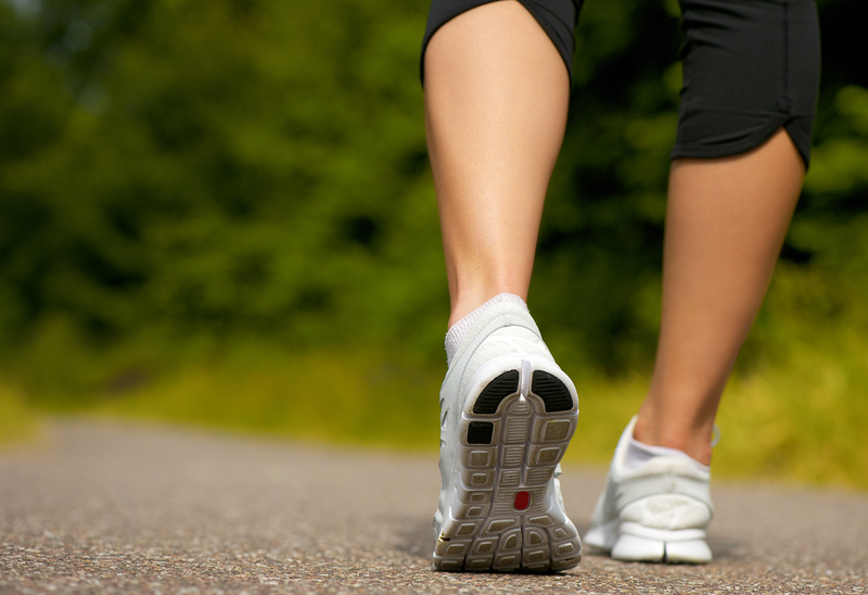 http://www.dreamstime.com/stock-images-female-walking-outdoors-running-shoes-behind-image32368964