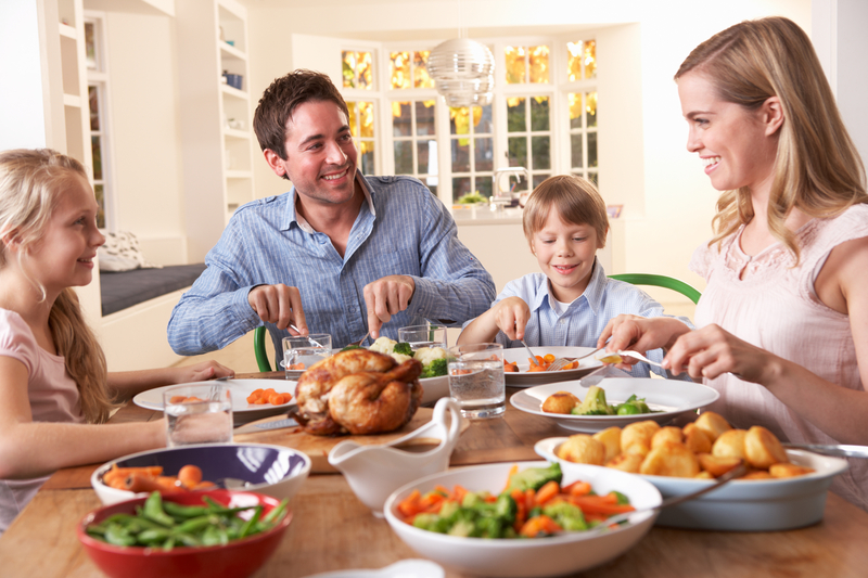 http://www.dreamstime.com/royalty-free-stock-images-happy-family-having-roast-chicken-dinner-table-image18044089