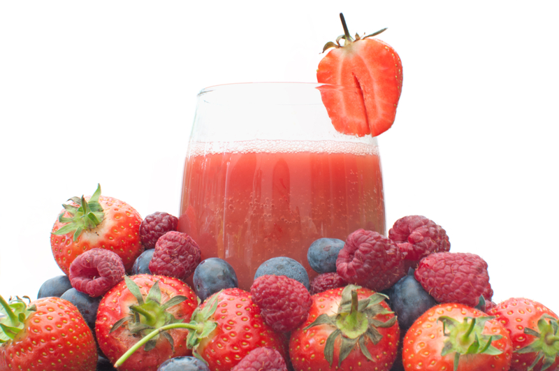 http://www.dreamstime.com/stock-photography-berry-smoothie-fruit-juice-glass-surrounded-large-pile-berries-image32119432