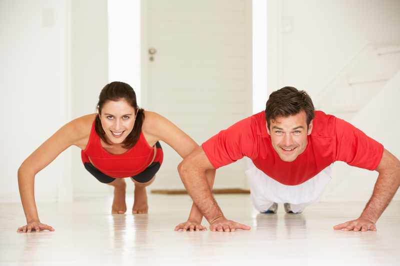 http://www.dreamstime.com/royalty-free-stock-photo-couple-doing-push-ups-home-gym-image21049185