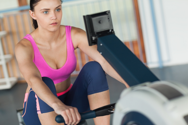 http://www.dreamstime.com/royalty-free-stock-photo-woman-working-out-row-machine-fitness-studio-determined-young-image35790425