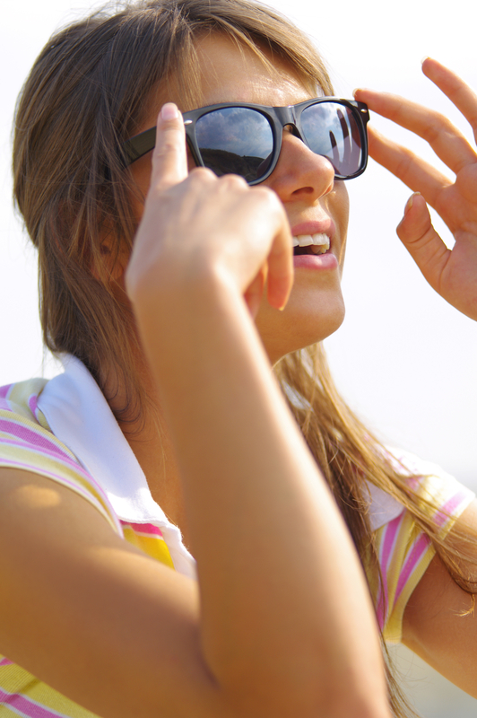 http://www.dreamstime.com/stock-image-beautiful-woman-sun-glasses-young-sitting-sunlight-black-image38974141