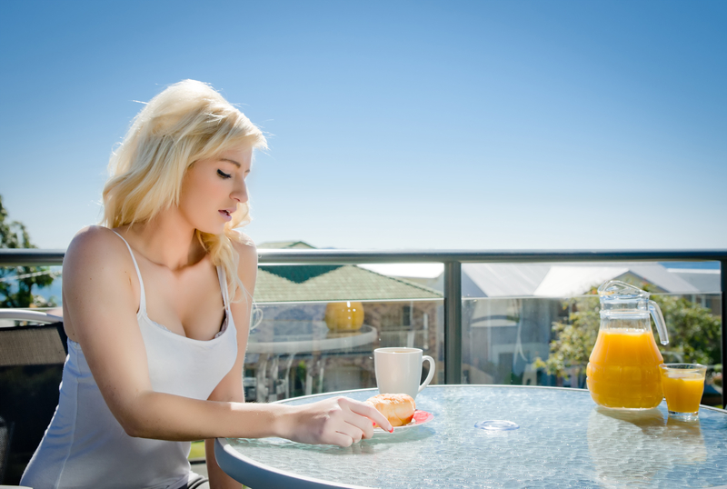 http://www.dreamstime.com/royalty-free-stock-image-young-woman-having-breakfast-image15952796