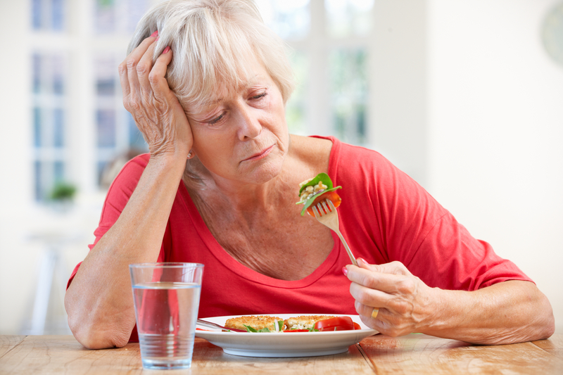 http://www.dreamstime.com/stock-photo-sick-older-woman-trying-to-eat-image25391820