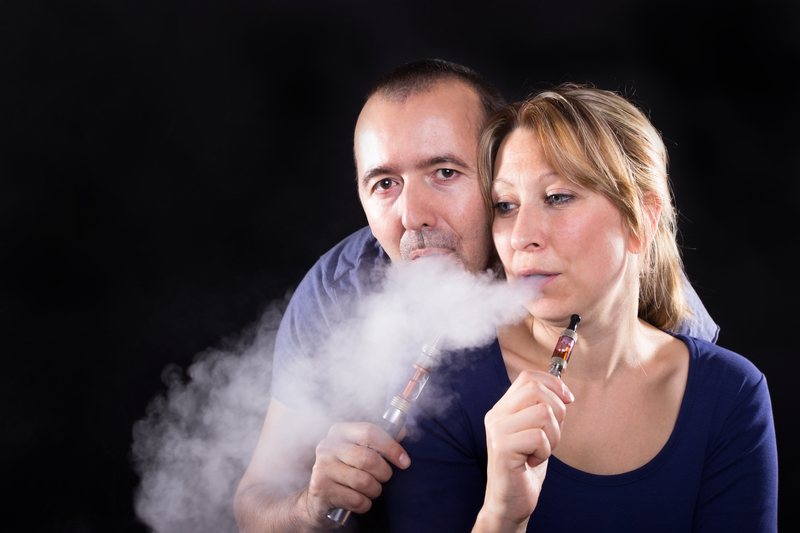 http://www.dreamstime.com/royalty-free-stock-photos-couple-electronic-cigarettes-enjoying-e-cigarette-together-image35877618