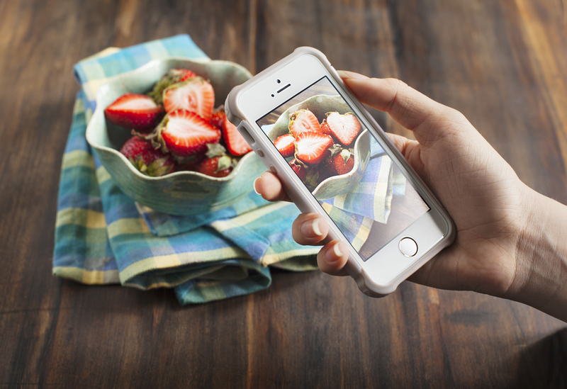 http://www.dreamstime.com/stock-photo-smartphone-shot-food-photo-hands-taking-fresh-strawberry-image40463720