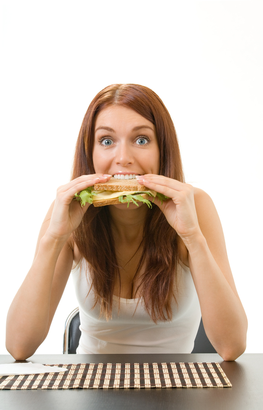 http://www.dreamstime.com/royalty-free-stock-photography-hungry-gluttonous-woman-eating-image6451557