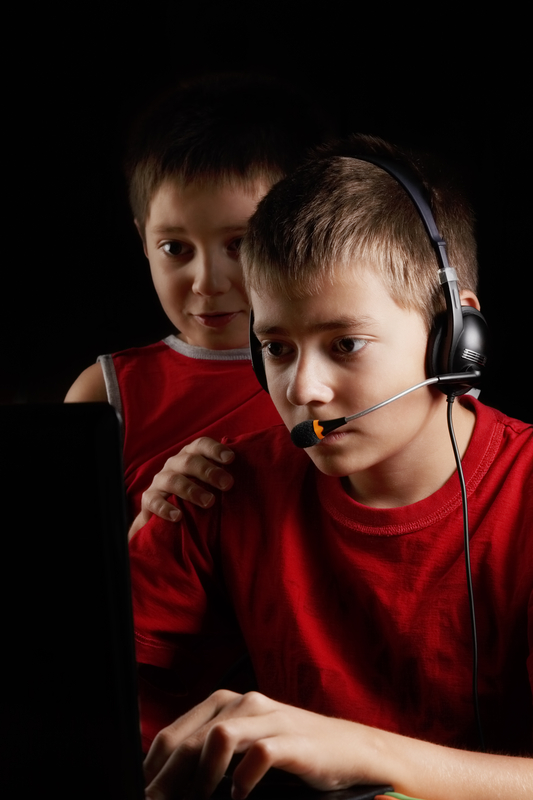 http://www.dreamstime.com/stock-photos-kids-playing-computer-game-darkness-image32913393