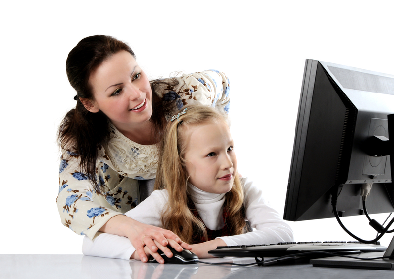 http://www.dreamstime.com/stock-image-mother-daughter-using-computer-image24062621