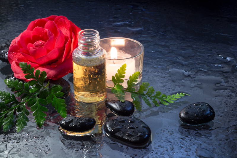 http://www.dreamstime.com/royalty-free-stock-images-fern-candle-oil-black-stones-massage-image30061009