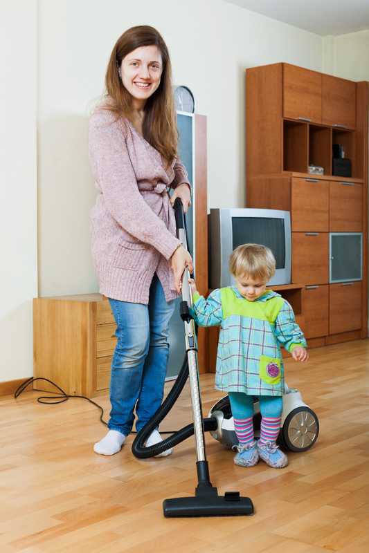 http://www.dreamstime.com/royalty-free-stock-image-mother-her-child-doing-home-cleaning-young-vacuum-cleaner-image41071106