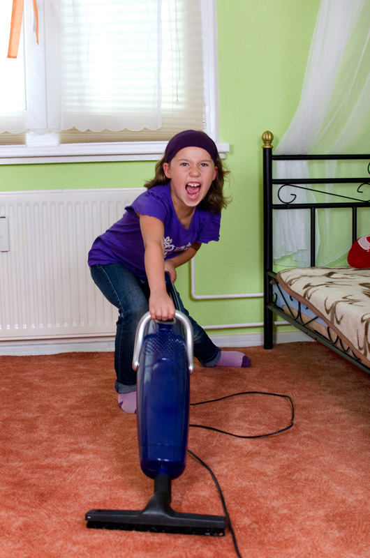 http://www.dreamstime.com/royalty-free-stock-photography-girl-vacuuming-cries-her-room-image36685837