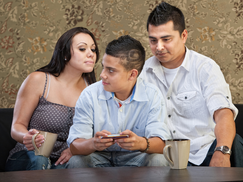 http://www.dreamstime.com/stock-photos-hsiapanic-parents-watching-son-clever-hispanic-teenager-watch-his-text-messaging-image33029143