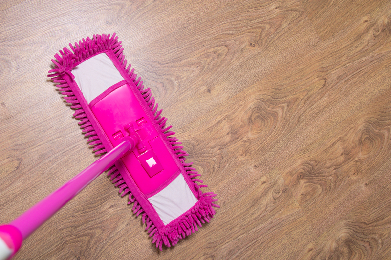 http://www.dreamstime.com/royalty-free-stock-photography-cleaning-wooden-parquet-floor-pink-mop-wet-image40193557