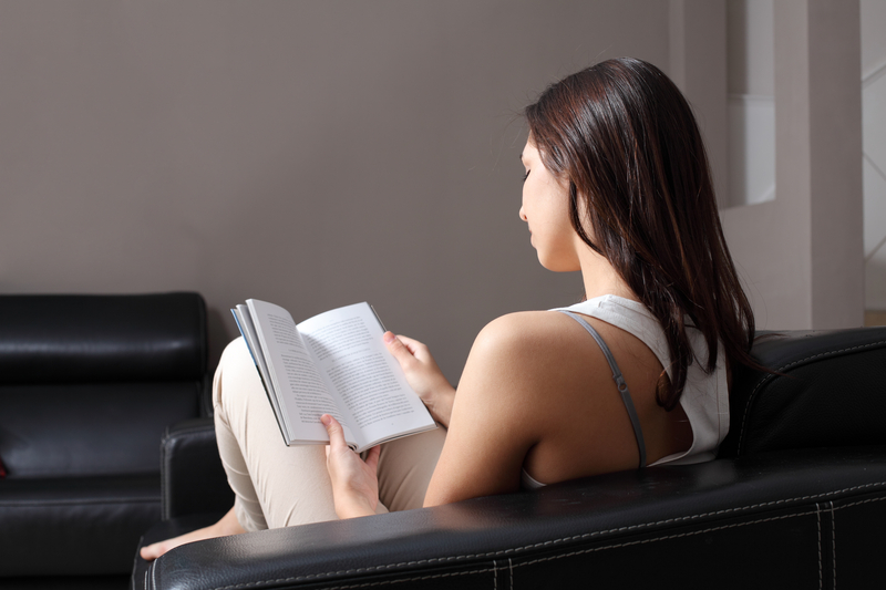 http://www.dreamstime.com/stock-photos-beautiful-woman-home-sitting-couch-reading-book-image29587813