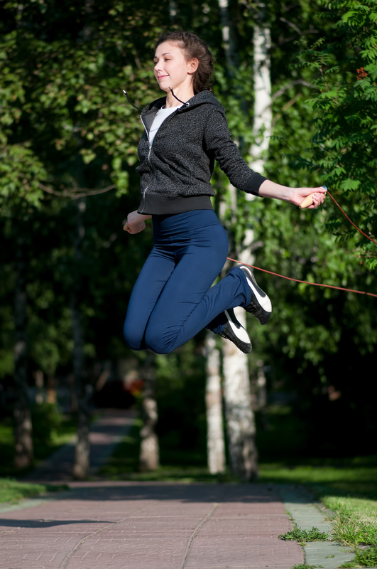 http://www.dreamstime.com/royalty-free-stock-image-jumping-woman-skipping-rope-park-image18133576