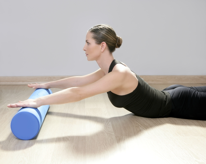 http://www.dreamstime.com/stock-images-foam-roller-pilates-woman-sport-gym-fitness-image19120984