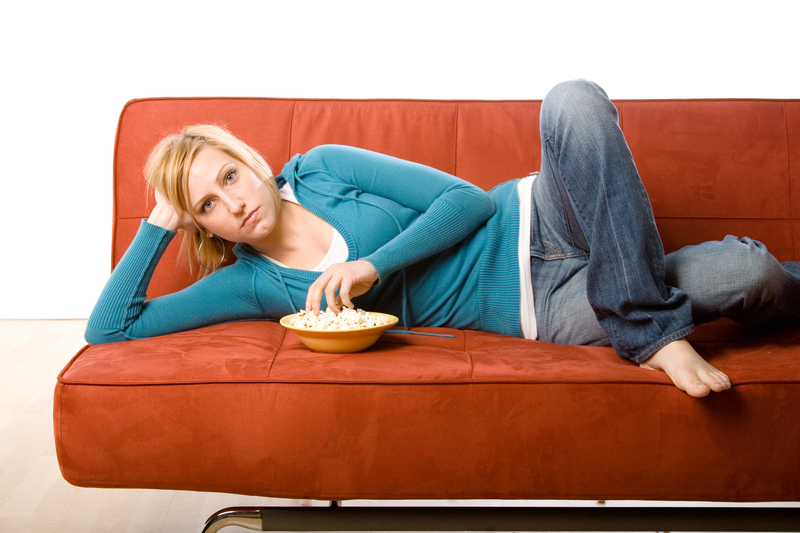http://www.dreamstime.com/royalty-free-stock-photography-woman-eating-couch-image2256607