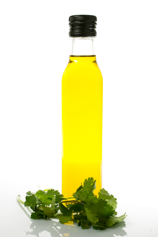 http://www.dreamstime.com/stock-image-bottle-olive-oil-fresh-cilantro-white-background-image30049251