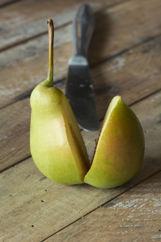 http://www.dreamstime.com/royalty-free-stock-photography-delicious-ripe-sliced-pear-wooden-table-image32140227