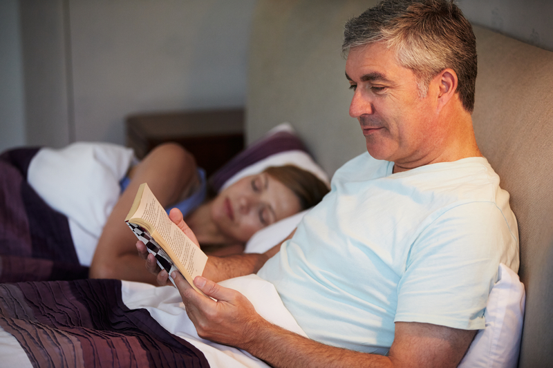 http://www.dreamstime.com/royalty-free-stock-photography-middle-aged-couple-bed-together-man-reading-book-next-to-wife-image34154767